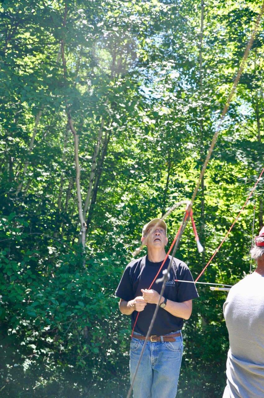 Alan K1MZM Watches carefully as dipole antennas are hauled high into the trees