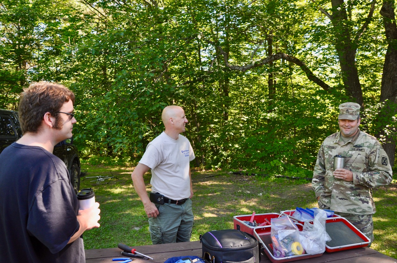 Chris & Chris discuss tent plans with a gentleman from the Vermont National Guard
